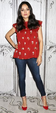 Spotted at the AOL Building promoting her new movie, Bad Moms, Mila Kunis expertly dressed for her growing baby bump with a blouse-y red floral top and A Pea in the Pod's AG Maternity Jeans | from InStyle.com