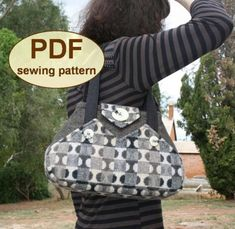 """Another classy handbag by Charlie's Aunt. A 1940's inspired """"Exchange"""" Bag, has uniquely shaped pockets on both sides, and fastens easily with a flap. This chic bag is practical in size and style.  The Exchange Bag is made with a sturdy gusset base so it stands up without sagging. This handbag can be created using three contrasting fabrics to make it your very own.  Get the Pattern ♥"""
