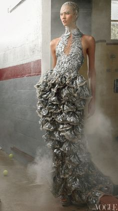 Supermodel Karlie Kloss in Alexander McQueenSpring 2012silver-sequin appliqué dress. More at http://weddinginspirasi.com/2011/10/07/alexander-mcqueen-spring-2012-ready-to-wear/
