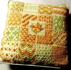 Vintage needlepoint pillow bargello geometric wool hand made coral orange green. Amazing variety of bargello designs are exhibited in the wonderful pillow. Seventeen squares, each with a different dazzling, geometric design. Lovely soft colors. A border with another intricate design. The pillow is backed with cream corduroy. The edging is rimmed with matching cording encased in corduroy fabric.  Wool crewel thread. A 13 inch zipper enclosure. Removable insert pillow.  15 ½ inches square –…