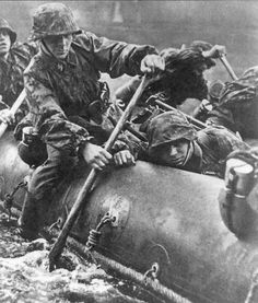 Waffen-SS troopers row through the harsh waters of Eastern Europe via raft while tasked with a special counter-offensive operation against Soviet forces. In many cases, the missions which even the most hardened Wehrmacht troops could not complete saw High Command send in the men of the SS. With priority status, they were issued the latest and most advanced military equipment available in the Reich to see through to the end the most demanding operations.