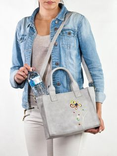 """Travel in colour with a curious ladybug as it weaves its way towards beautiful, blossoming petals. Carry your lunch in style while keeping it cool with this insulated purse! There is a top zipper to keep everything secure, and a detachable long strap if you want to carry it hands-free. Size: 10.5""""w x 8""""h x 4.5""""dMateri Insulated Lunch Bags, Keep Cool, Ladybug, Size 10, Hands, Zipper, Colour, Purses, Free"""