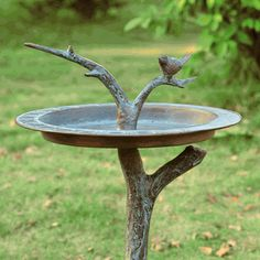 """Bird & Twig Birdbath / Sundial. With a realistic mossy green branch serving as sturdy base and stand, our attractive combination birdbath and sundial is the perfect a nature-themed accent piece for your garden. Weather-resistant aluminum construction features a branch appearing to come through the basin with an adorable bird perched atop it. $124.00  Dimensions: 15.5""""w x 15.5"""" x 27""""h  Weight: 5.6 lbs  Material: Aluminum"""