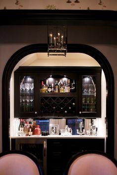trad cabinets. wine+ bottle storage. mirror splash back.