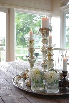 simple pretty little dining room/kitchen table centerpiece- silver tray w/ mercury glass candlesticks, flowers in bud vases Table Centerpieces, Table Decorations, Glass Candlesticks, White Candles, Candle Lanterns, Tray Decor, Mercury Glass, Glass Table, Interior Design Living Room