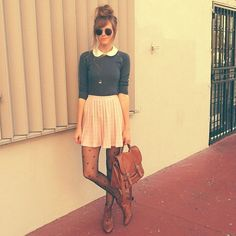 Collar sweater, pleated skirt, heart tights + satchel + high messy bun that sweater thing: