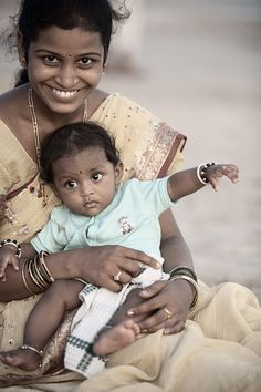 An Indian mother and child at Palolem beach in the evening. - Palolem, Goa, India -