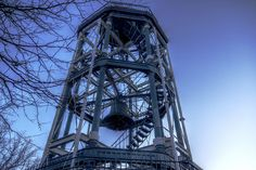 The Harlem Fire Watchtower is located in Marcus Garvey Park atop Mount Morris. It is the last of eleven fire alert bells in New York City and was constructed from cast iron by Julius Kroehl based on designs of James Bogardus, a pioneer in American cast-iron architecture. Ironically, the other fire towers were mostly constructed of wood and some were consumed by fire.