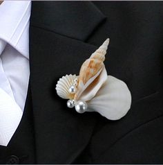 Seashell Boutonniere: Beach Wedding / http://www.putitoutthere.com.au/bouquets-button-holes-petals-button-hole-corsage-c-181_202/seashell-boutonniere-p-5877