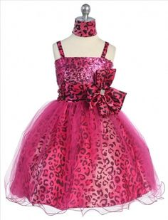 A gorgeous animal printed shiny satin puffy dress, covered with tulle material. Accented big bow with jewel pin on the side of waist line. Perfect for Flower Girl, Junior Bridesmaid, Pageant, Graduation and Holy Day Party. Fully lined.    Sizes Available 2-16    Colors Available Purple, Fuchsia, Turquoise    Made int the U.S.A.  $69.00