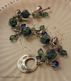 Charm bracelet I made with boro lampwork beads, jade, silver, and crystal.
