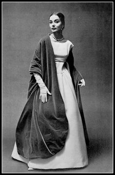 Model in white satin ball gown worn with immense velvet stole by Givenchy, photo by Georges Saad, 1956