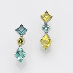 A pair of blue and yellow tourmaline clip-earrings, Paolo Costagli  with maker's mark for Paolo Costagli; estimated total tourmaline weight for the pair: 6.40 carats; mounted in eighteen karat white gold