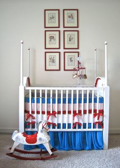 Custom-designed baby's crib, rocking horse, & art collage. #redwhiteandblue #interiordesign