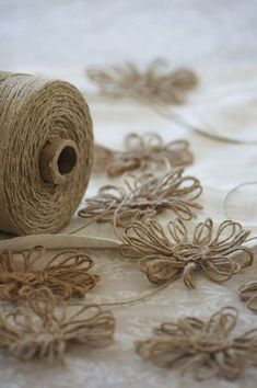 jute flowers (I wonder if I could figure out how to do these?)