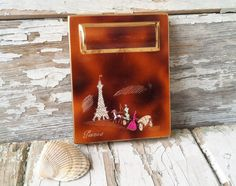 Check out this item in my Etsy shop https://www.etsy.com/listing/180941394/vintage-french-compact-antique-parisian