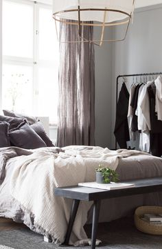 The beautiful bedroom of an interior designer Genevieve Jorn. Bench and clothes rail from Nordal