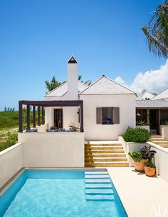 Decorator Tom Scheerer designed his Bahamas getaway as a compound comprising six pavilions interspersed with Coralina-stone terraces, gardens, and a swimming pool.