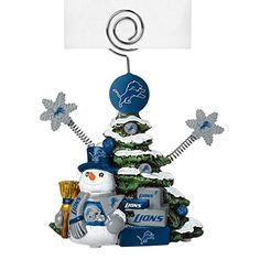 Beautifully detailed cold cast porcelain tree with snowman and presents. Decorated with colofrul team graphics, this table sop holder is great for holding photos, notes to santa or place cards. Detroit Lions Colors, Nfl Detroit Lions, Photo Holders, Photo Tree, Atlanta Falcons, New Orleans Saints, Decorative Pillows, Place Cards, Christmas Ornaments