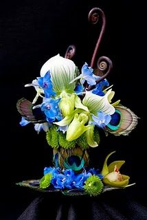 peacock feathers flower art design ~ white/green lady slippers, lt blue delphinium, green athos poms