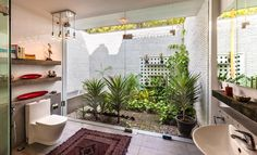 This bathroom fuses the outdoors with the indoors, making it feel as if you're really amid nature. What a relaxing little retreat from the world. Design by Kumar Moorthy & Associates. Check out #homify for more beautiful bathrooms like this one.  #house #home #interiordesign #interiordecor #homedesign #homedecor #bathroomideas #cosystyle #modernbathroom #moderndesign #designinspiration #designinspo #bathroominspo #scandinavian