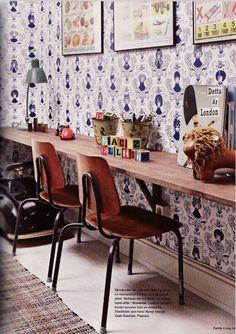 wallpaper accent wall, desk, shelves above desk
