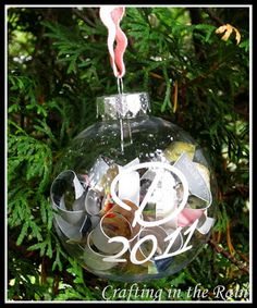 Wedding Gift: Take their wedding invitation, cut into strips and placed in a glass ball. Give to newlywed couple for their first Christmas. Would work for baby showers and other things too.