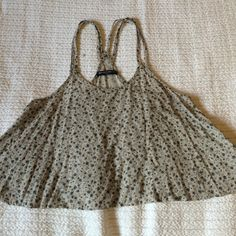 Floral Brandy Melville Tank/Crop Very cute and flowy. Thin for a perfect spring top. Never worn. Amazing condition. No flaws. Brandy Melville Tops