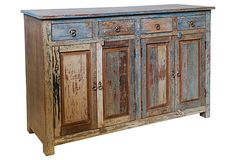 Odessa 4-Drawer Buffet Table made of reclaimed wood. I love the weathered look combined with more contemporary pieces.