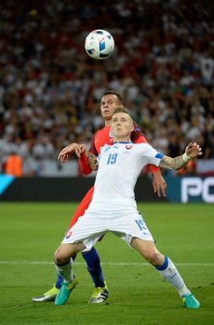 #EURO2016  Juraj Kucka of Slovakia heads the ball with Dele Alli of England during the UEFA EURO 2016 Group B match between Slovakia and England at Stade...