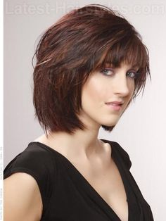 Love the texture but may still want asymmetry. Layered Brunette Shag Cut with Red Highlights