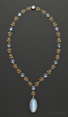 Arts  Crafts Moonstone and Split Pearl Necklace, Tiffany  Co., c. 1915-20, the large oval cabochon moonstone measuring approx. 30.00 x 16.10 x 10.50 mm, within a platinum bezel with foliate engraving, suspended from a chain of 18kt gold and split pearl lyre-form links spaced by cabochon moonstones in platinum bezels, chain lg. 18 5/8 in., signed Tiffany  Co. on the drop and on the clasp.