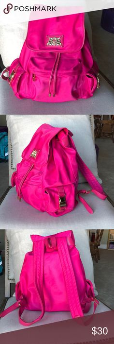 Hot pink nylon and leather backpack Pink is my signature color...spacious and light, this many-pocketed bag stands out in megawatt pink with gold accents. Not only has it traveled the world, it has traveled around town on field trips and made the tween girls covet my mommy style. Juicy Couture Bags Backpacks