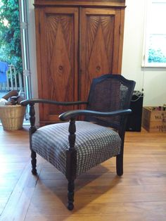 Wooden Armchair. Super comfortable and love the fabric from Martha~