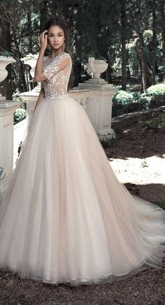 Gorgeously uniquely embroidered ballgown wedding dress with half sleeves; Featured Dress: Milva                                                                                                                                                                                 More