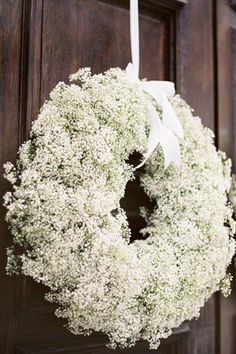 Gypsophila door wreath. I'd use as a base and add a seasonal spray, preferably scented