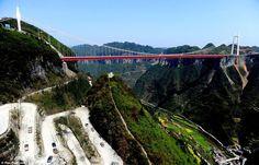 Don't look down.   the Anzhaite Long-span Suspension Bridge in Jishou, Hunan, China,    Read more: http://www.dailymail.co.uk/news/article-2124376/Anzhaite-Long-span-Suspension-Bridge-Worlds-highest-bridge-gets-finishing-touches.html#ixzz1qzzo55O4