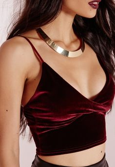 """Channel Goth vibes in this seriously seductive crushed velvet crop top. Featuring adjustable spaghetti straps and bodycon fit, wear with a leather mini and stacked heels for a kick ass autumn look.  Approx length 28cm/11"""" (Based on a UK ..."""
