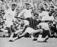 9th August 1969. Crystal Palace Steve Kember battling against Manchester United Denis Law, David Sadler and Bill Foulkes during their opening top flight game.