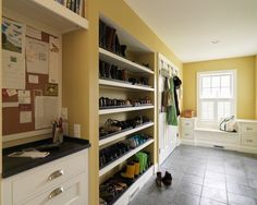Love some of the elements in this mudroom. LOVE the shoe area, plus a command center is a must!