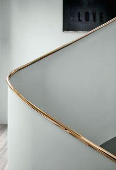stunning copper metal handrail that contrasts Staircase Handrail, Curved Staircase, Staircases, Stair Railing, Banisters, Balustrade Design, Railing Design, Staircase Design, Stair Design