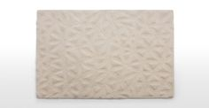 A handmade wool rug, 120 x 170cm, in cream, from the Tekari collection.