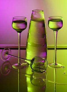 green and violet glass carafe and wine glasses