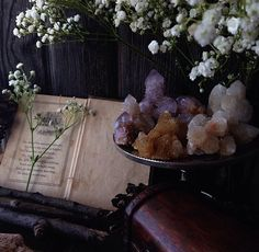 Magic book with crystals and flowers