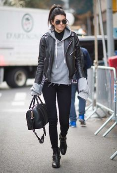 Kendall Jenner. Oversized sweatshirt under a black leather jacket
