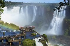 Make your way from Foz do Iguacu or Puerto Iguazu to the Brazilian side of the Iguazu Falls, a UNESCO World Heritage site. See a chain of 275 breathtaking falls including the Devil's Throat and take in the amazing views of this natural wonder. Iguazu National Park, Parc National, Vacation Places, Vacation Destinations, Holiday Destinations, Walking In The Jungle, Chutes Victoria, Iguazu Waterfalls, National Geographic Photographers