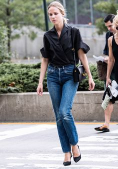 High-rise jeans, a black button-up and pointed black pumps