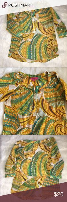 """Trina Turk for Banana Republic Blouse.  SZ 2. Beautiful, colorful tunic style blouse from the 2012 Trina Turk for Banana Republic Collection.  67% Cotton 33% Silk.  Vibrant shades gold, turquoise, lime green, brown and ivory.  Size 2.  3/4 sleeves, 5-button opening at neckline.  Front button placket and sleeves are trimmed in green grosgrain ribbon. Ribbon on sleeves does show some light fraying (see pic).  Approximate Measurements: Bust Flat Across - 18"""" Sleeves - 18"""" Overall Length - 23""""…"""