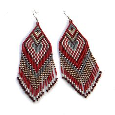 Hey, I found this really awesome Etsy listing at https://www.etsy.com/listing/175268216/large-dark-red-seed-bead-earrings
