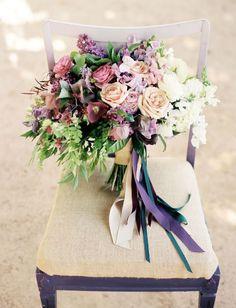 Purple bouquet: Purple clematis, hellebores, sweet peas, quicksand roses, ranunculus, muscari + maiden hair fern.
